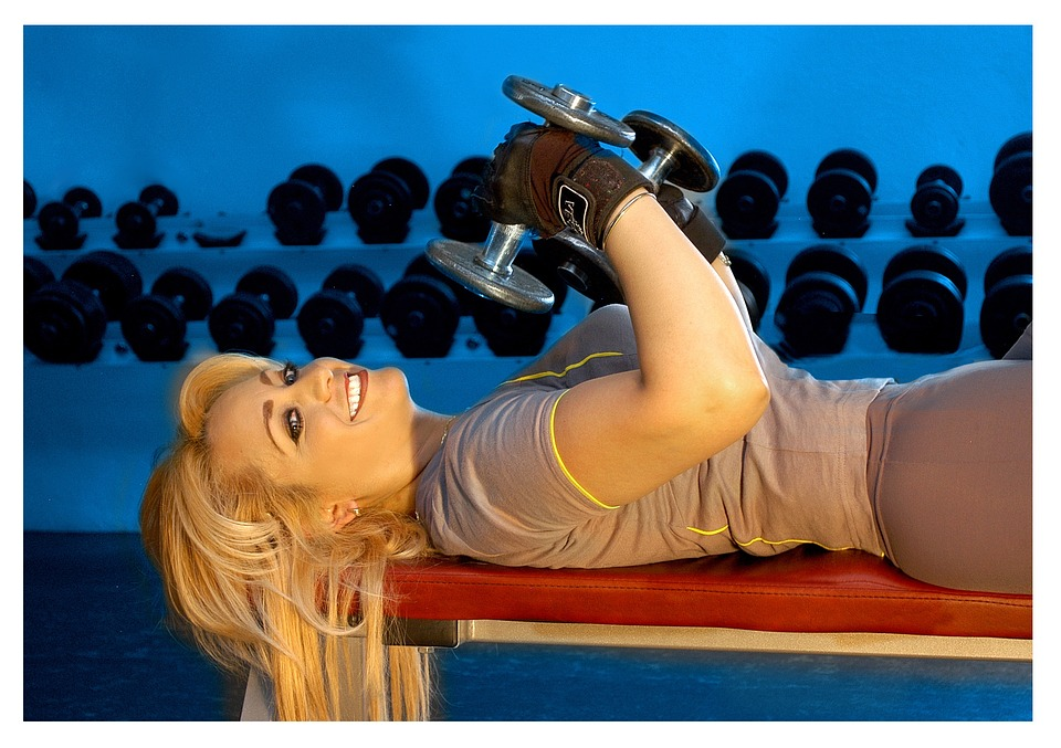 woman lying on a weight training bench