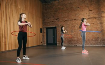 3 woman hula hooping with social distancing