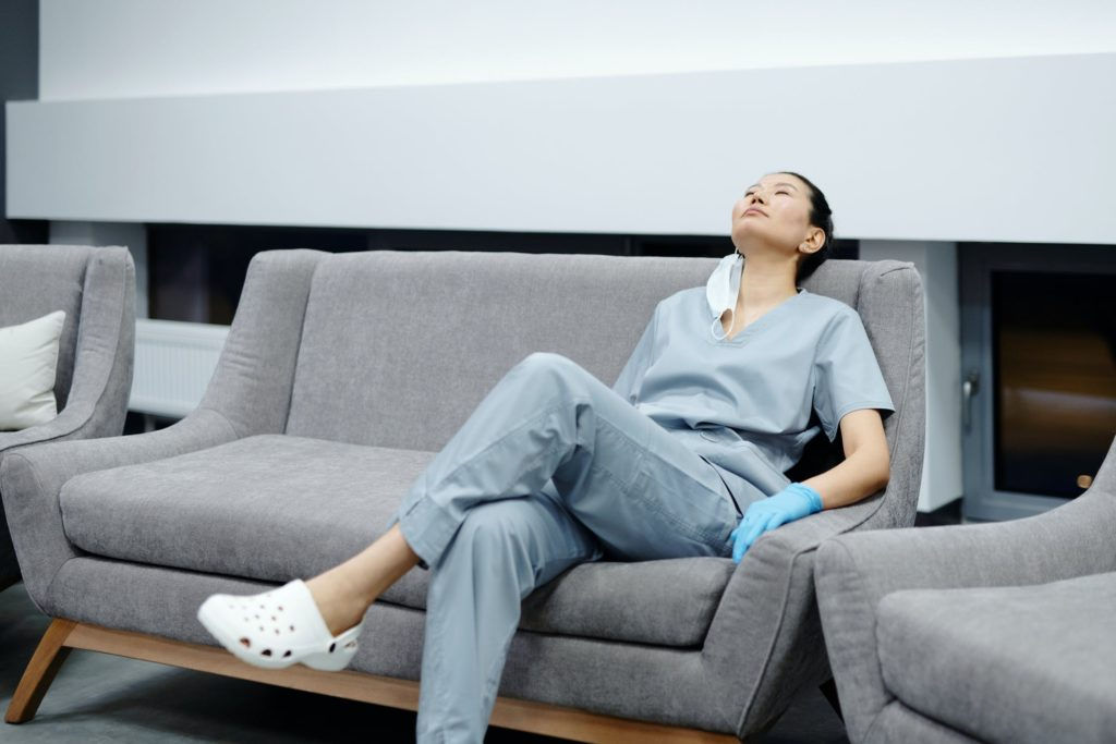 nurse resting on a couch