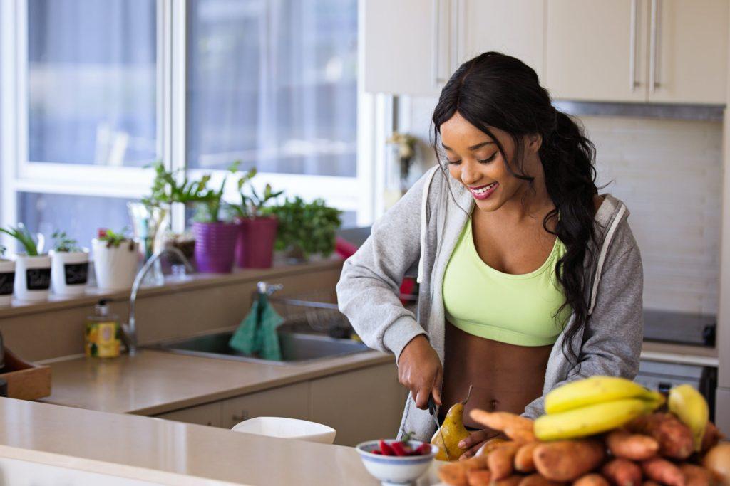 woman preparing healthy fruit in her kitchen