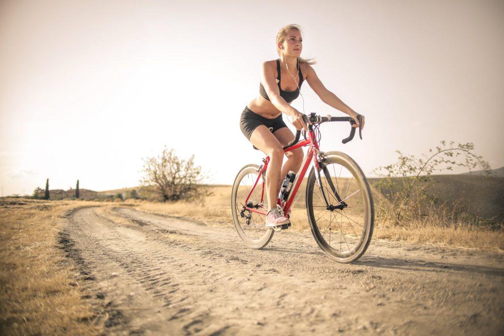 woman riding a bike on a track