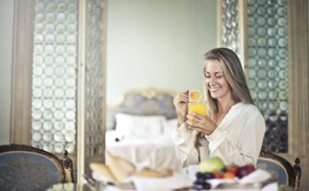 woman with a detox juice drink
