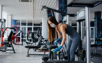 woman cleaning a gym