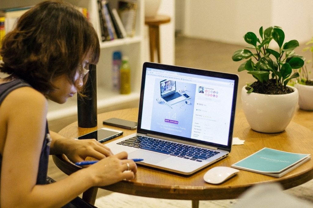 woman working from home dining table