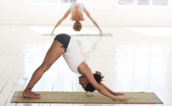 downward dog yoga pose by women