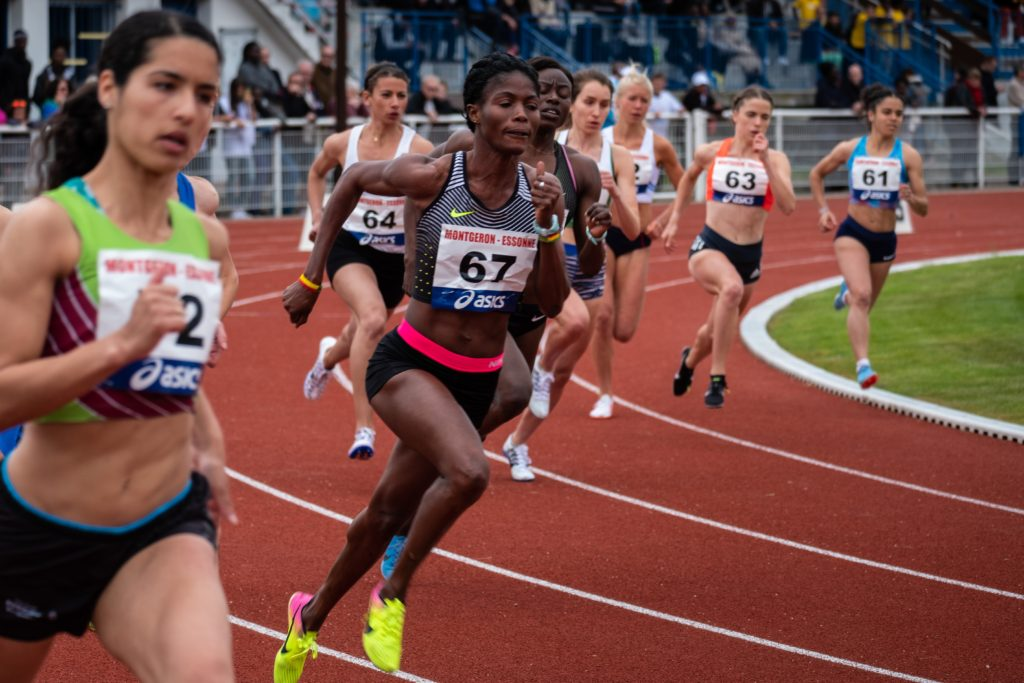 women sprinters racing on a track